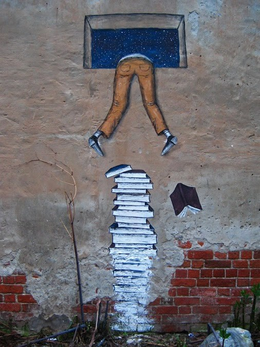 Street-Art-Climb-Over-Books (1).jpg