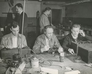 Several veterans looking at radio equipment