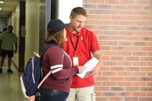 Principal Hoerl assisting student.