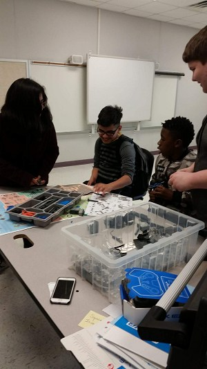 Students working with robot kits