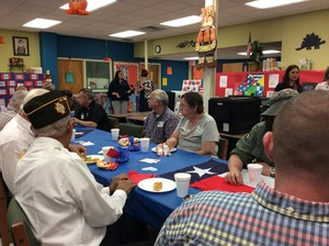 Veterans eating in the cafeteria.