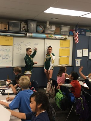 Tahquitz Cheerleaders teaching students long division.