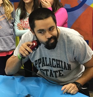 Coach Hawkins shaves his beard for Jump Rope for Heart