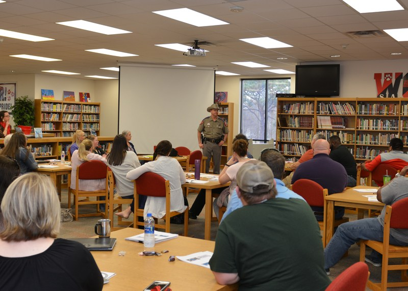 Officer speaking with school staff