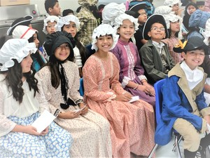 Tracy Elementary School fifth-graders await their turns on stage during the school's fifth annual Colonial Fest, held March 30. Students gave presentations, sang and danced – all while dressed in Revolutionary Era outfits.