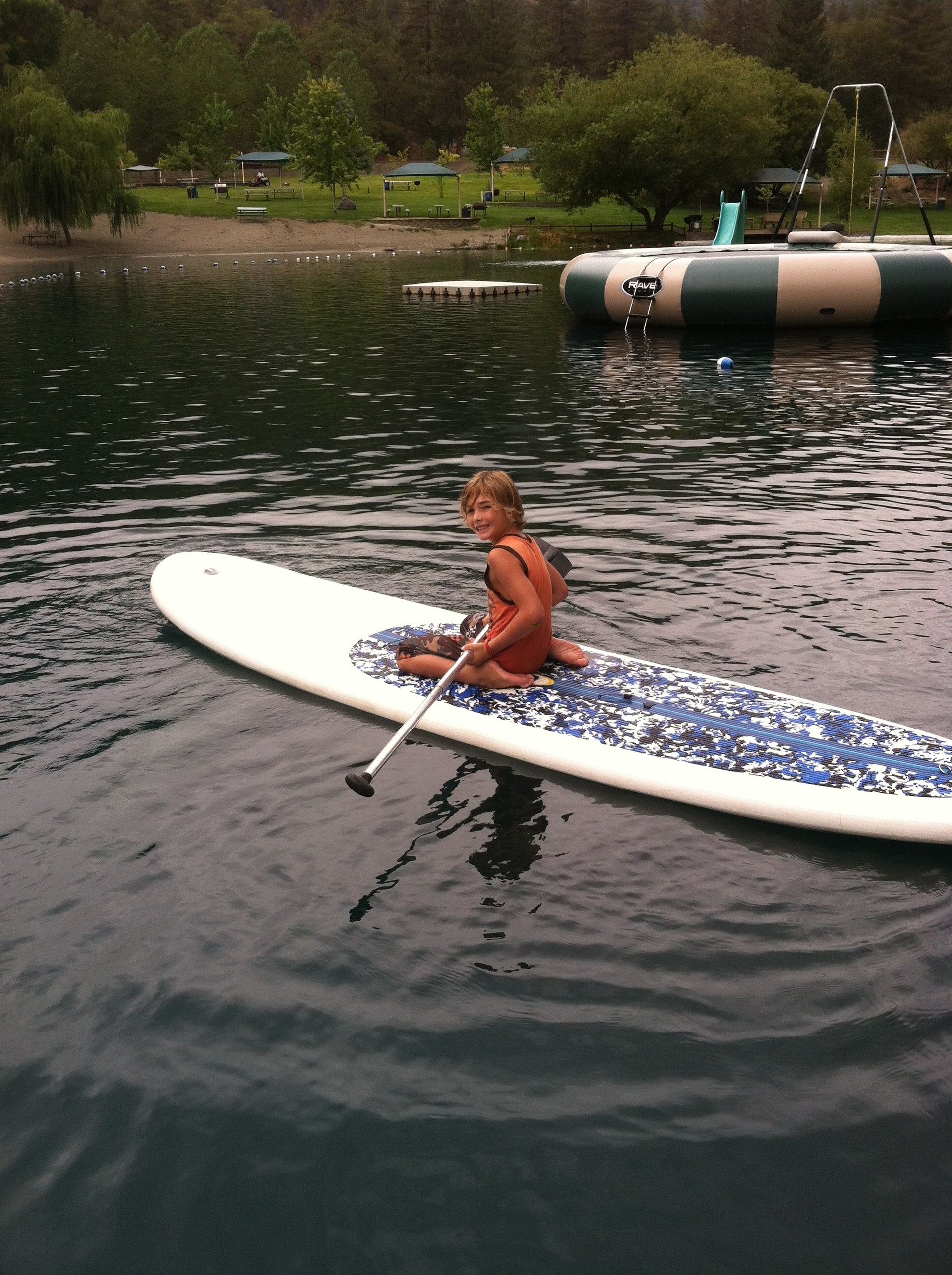 Student paddle boarding SUP