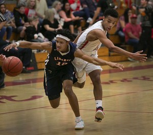 Isaiah Hill chases after a loose ball