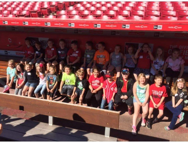 Picture of Students in reds dugout