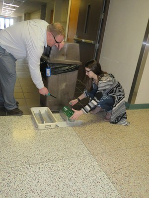 A TKHS student tests her hydrogen bottle in the hallway.
