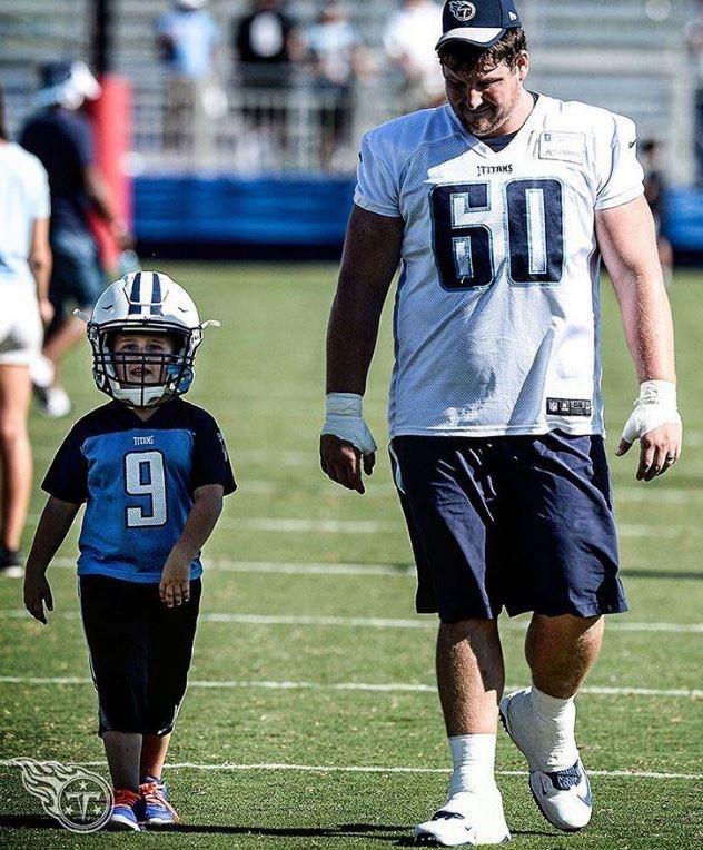 Titan's Ben Jones with child athlete