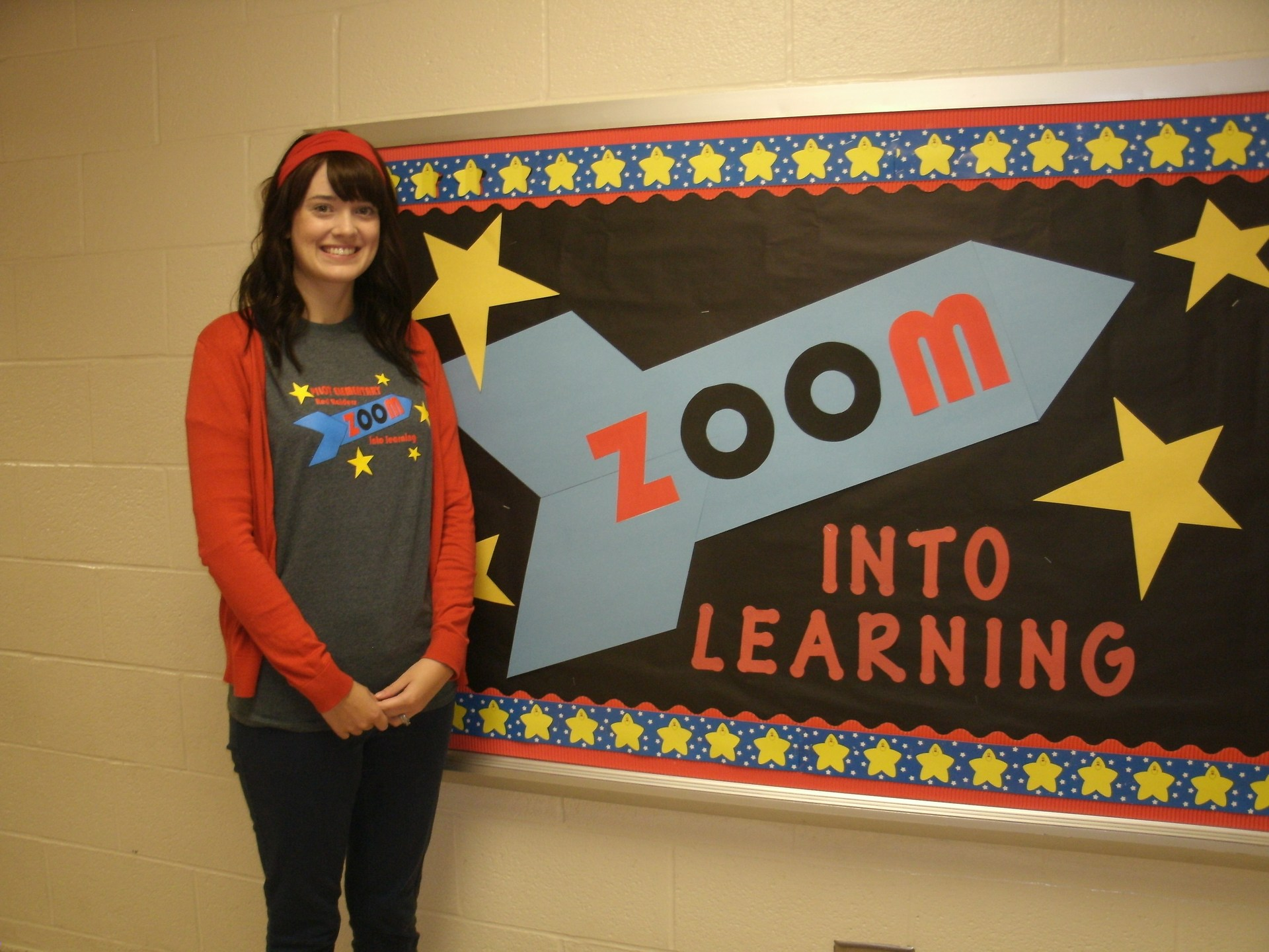 Erica Altamirano is standing in front of a bulletin board.