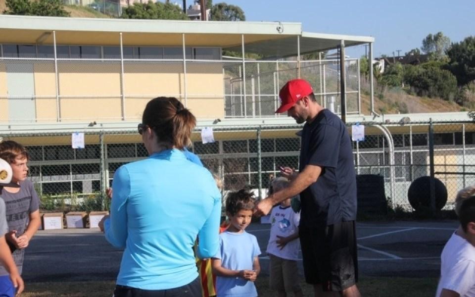parent volunteers checking laps run