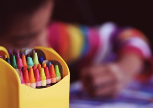 Student with crayons.