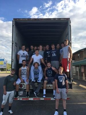 EHS Varsity team members loading donations