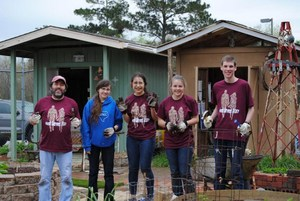 STEM group working at the community garden.JPG