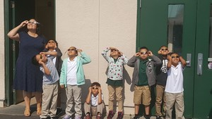 Principal joins with students to watch Solar Eclipse