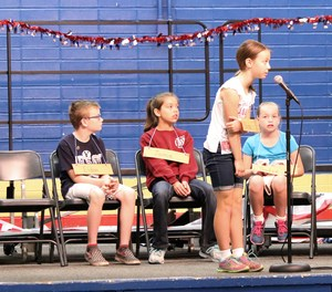 Naida Israelson answering a question at the Battle of the Books.