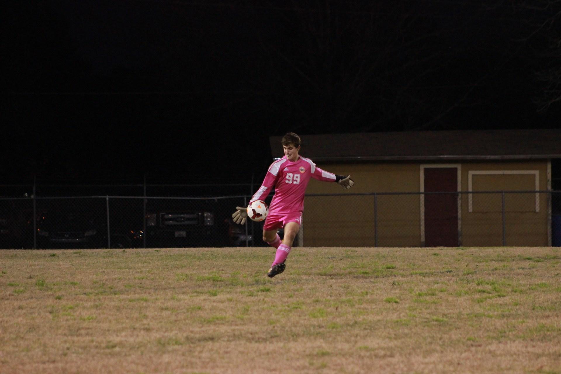 Grant S. kicks the play to his team members.