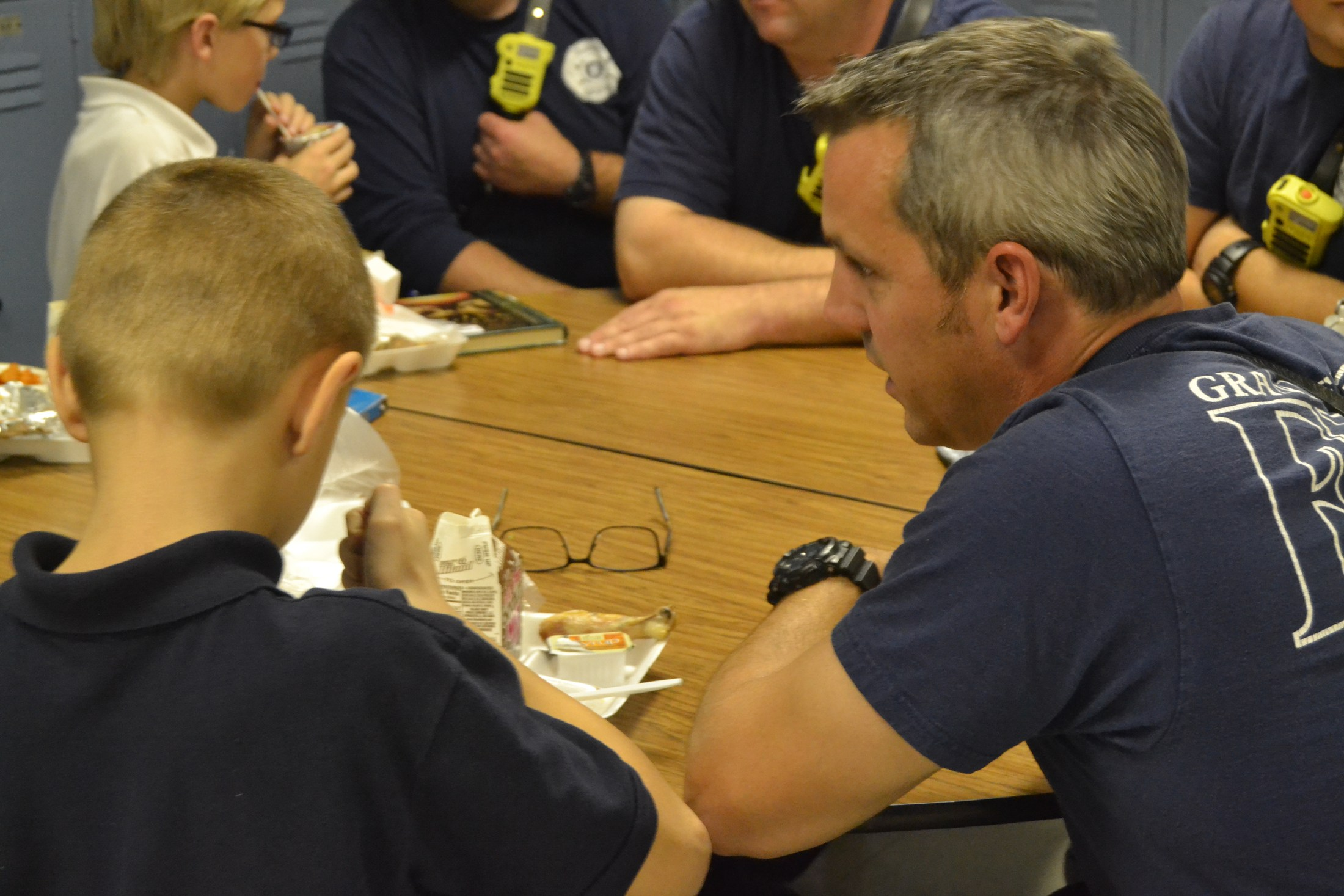 Firefighter mentoring students.