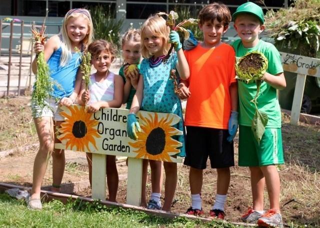 children smiling in garden