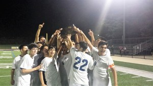 The Garcia Boys Soccer team celebrates winning their sectional championship game.