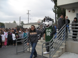 Northrup Instructional Specialist Dr. Ana Escobedo and the ELAC Husky meet students to take them to the new GO Northrup College and Career Readiness Center.