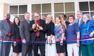 Ribbon Cutting Ceremony held on August 11, 2017. In the photo, from left to right: Brian Francis, Dr. Kelree Brasseaux, Councilman Rick Callahan, Karen Belknap, A+ Charter Schools Board Members