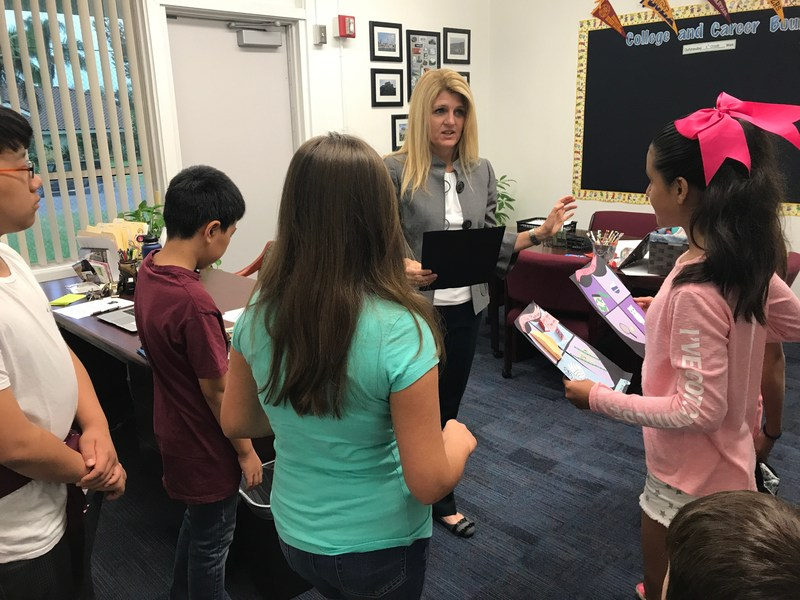 Students sharing their work with the principal.