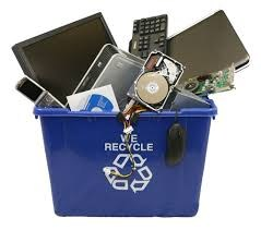 Electronic waste in a recycling bin