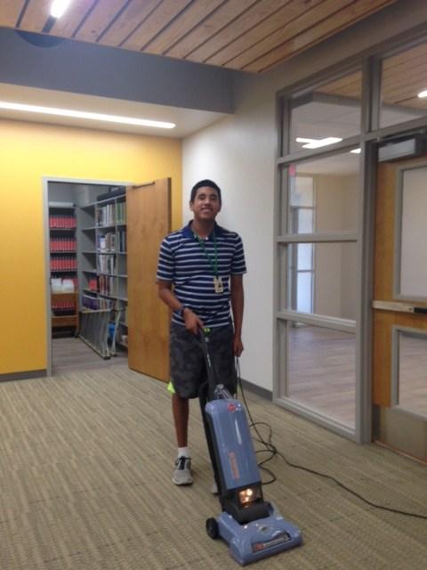 Boy vacuuming.