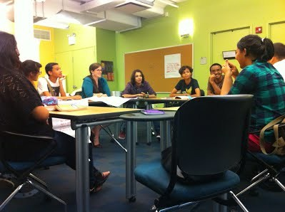 Students Sitting Around a Conference Table