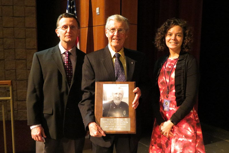 Don VerHage holds his award with OHS Principal Herve Dardis (left) and Director of Instruction Heather Kortlandt.