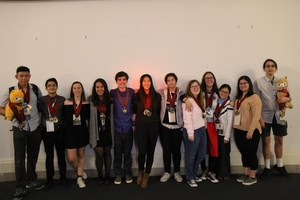 Photo of 2018 World Scholar's Cup Teams at Yale with medals and trophies