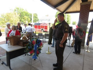 A Barry County Sheriff's Sgt. salutes the wreath placed in commemoration of all the 9-11 victims.