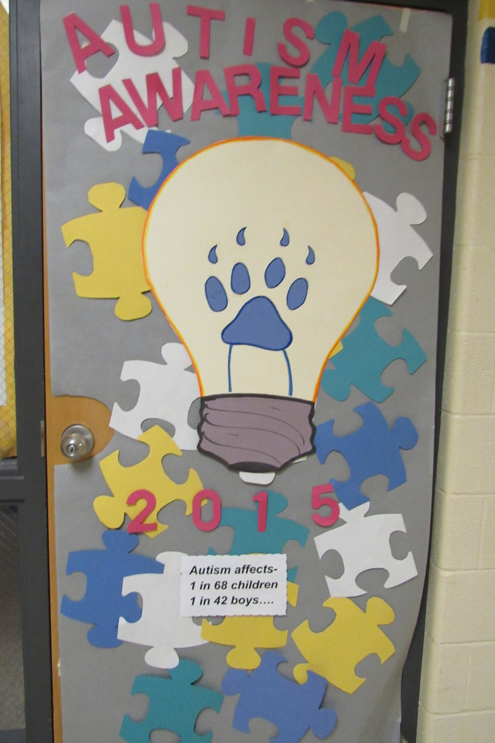 Door decorating contest for Light it Up Blue Autism Awareness