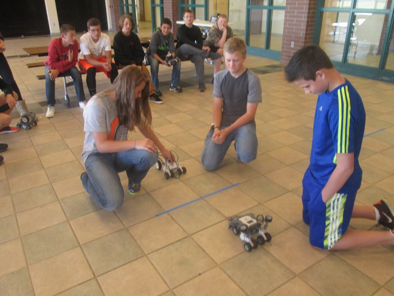 TKMS students test their LEGO robots in a tug-o-war contest.