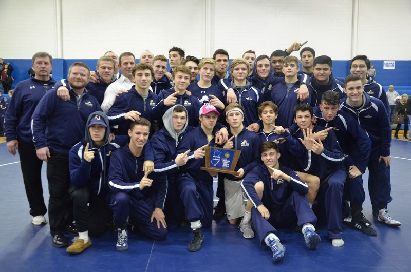 PJ wrestling team poses with sectional title