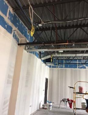 View of steel framework and dry wall on gym walls and ceiling
