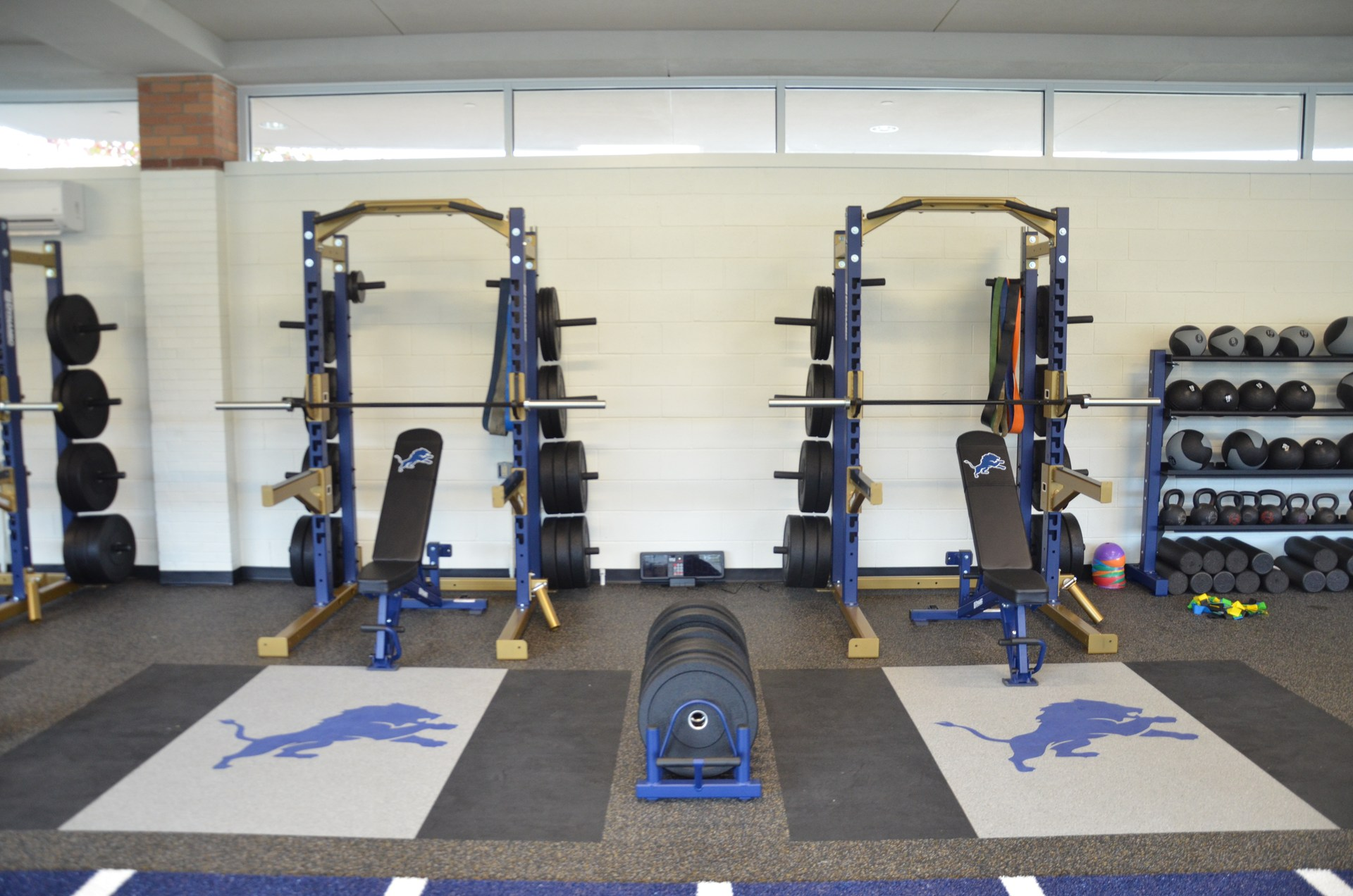 Two bench press racks in Coach Paternostro Training Center