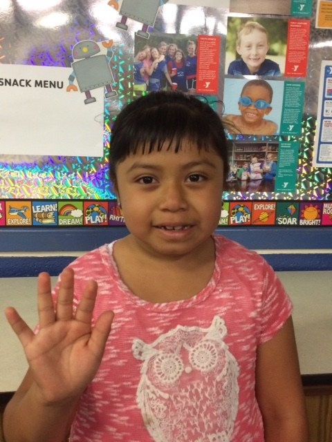 Eastfield Global Magnet School YMCA Afterschool Child waving