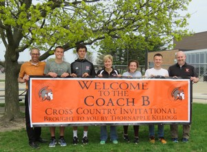 TK coaches and runners present a new sign for the