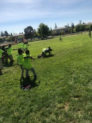 children racing on field