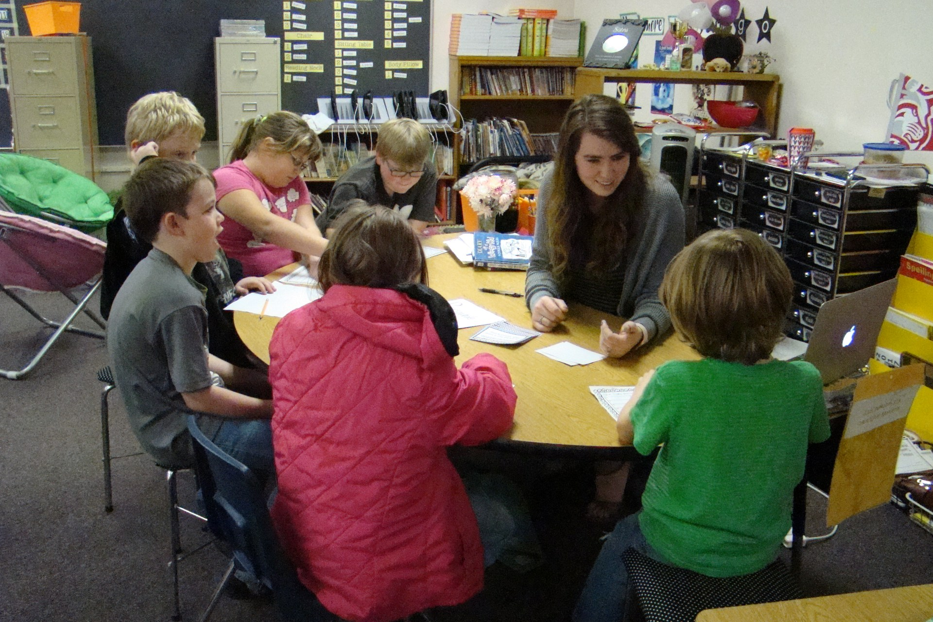 Teacher working with students.