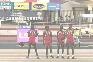 A photo of the Baker High track team after finishing in 3rd place at state championship meet