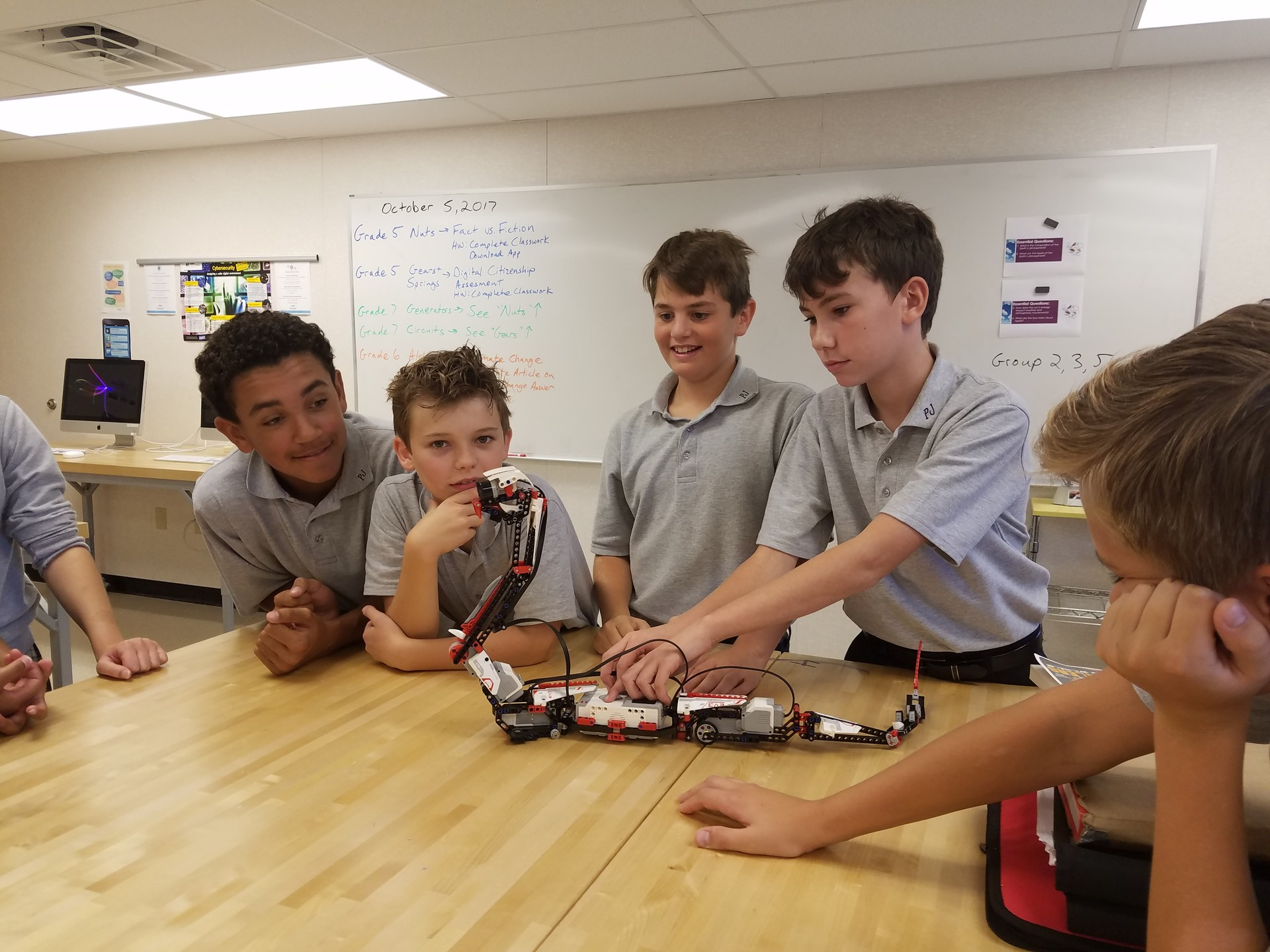 Group of boys build robot