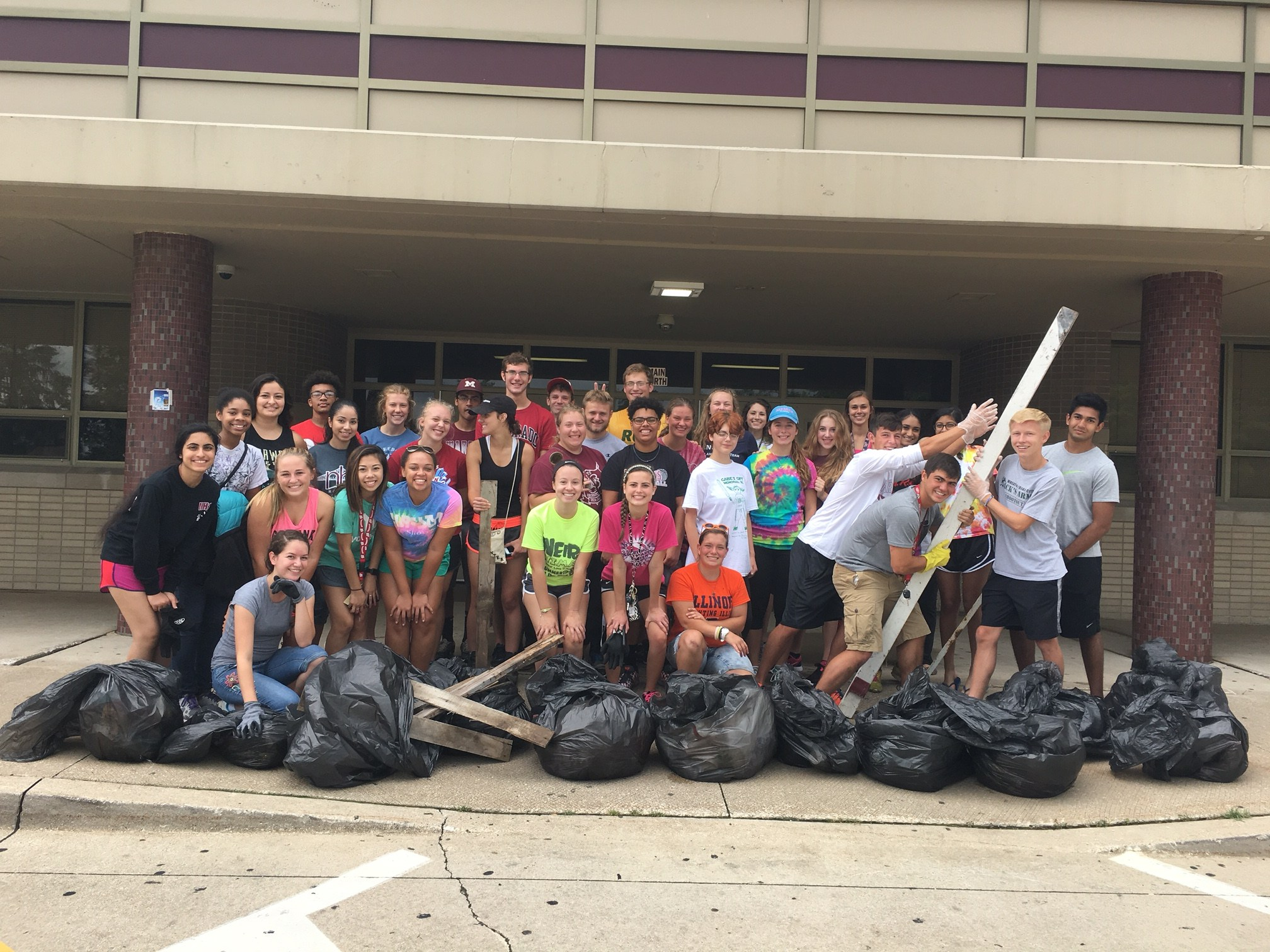 MHS Students posing after a grounds clean-up event.