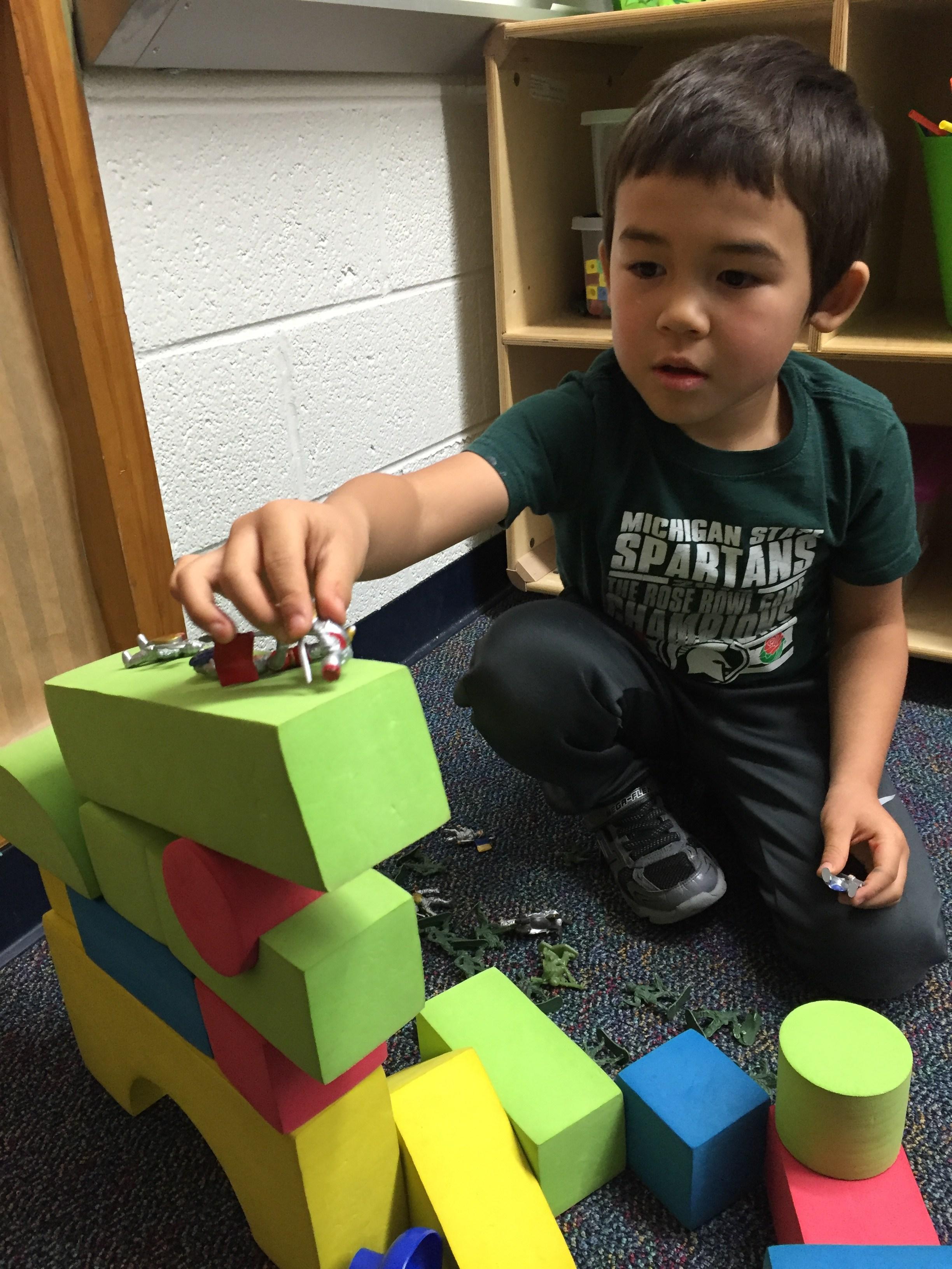 Kids' Club playing with blocks.