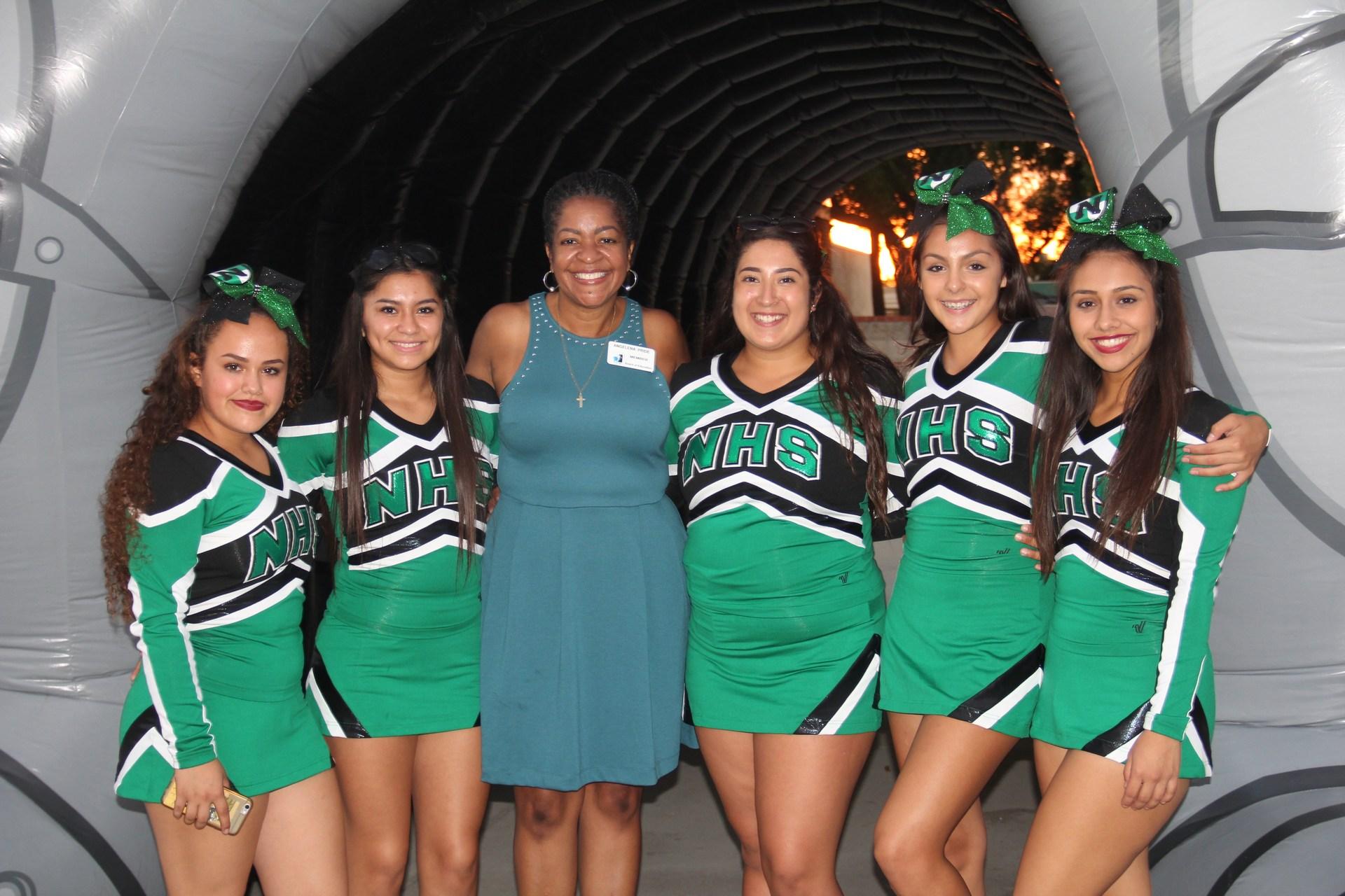 Cheerleaders with Board Member