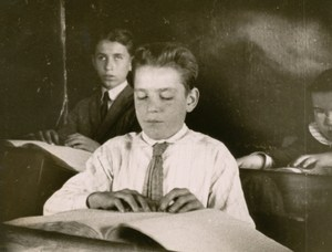 1917 students reading braille.