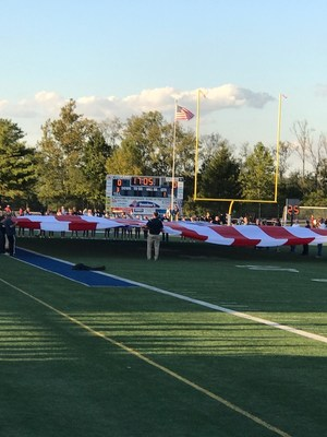 Displaying the American flag during Homecoming